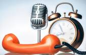 Clock, phone and microphone — Stock Photo