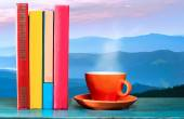 Books and coffee with mountains — Stock Photo