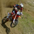 Постер, плакат: SIBIU ROMANIA JUNE 13: Marius Helmersen competing in Red Bull ROMANIACS Hard Enduro Rally with a KTM EXC motorcycle The hardest enduro rally in the world June 13 2014 in Sibiu Romania