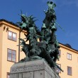 Sweden. Stockholm. Sculpture of St. George the Victorious striking sword dragon. — Stock Photo #53611479