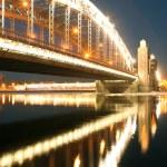 The Bridge of Peter the Great (Bolsheokhtinsky) in St. Petersburg at night. Russia. — Stock Photo #56536765