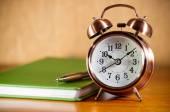 Retro alarm clock with books — Stock Photo
