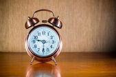 Retro alarm clock on table — Stock Photo