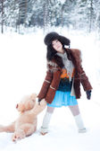 Beautiful girl on winter snowy forest background with teddy bear — Stock Photo