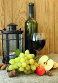 Autumn still-life with a glass of wine and grapes — Stock Photo