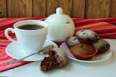 A cup of brewed coffee and chocolate muffins — Stock Photo