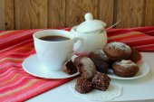 A cup of brewed coffee, cakes and sweets — Stock Photo
