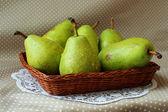 Green pears in a basket — Foto de Stock
