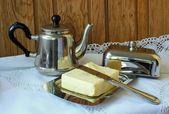Butter and teapot for tea — Foto de Stock