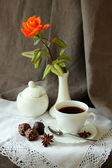 Still life with cup of coffee and a rose — Stock Photo