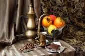 Still life with persimmons and coffee set — Stock Photo