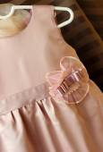 Children's silk dress with a decorative element on the belt — Stock Photo