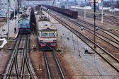 Passenger trains standing on the station platform, Odessa region, Ukraine, February 25, 2015 — Foto de Stock