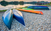 Parked Canoes by the lake at Sunset — Stock Photo