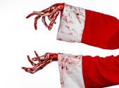 Christmas and Halloween theme: Santa Zombie bloody hand on a white background — Stock Photo