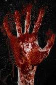 The bloody hand on the wet glass, the bloody window, an imprint of bloody hands, zombie, demon, killer, horror — Stock Photo