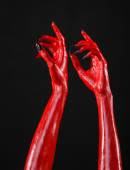 Red Devil's hands, red hands of Satan, Halloween theme, black background, isolated — Stock Photo