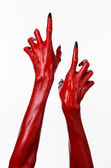 Red Devil's hands, red hands of Satan, Halloween theme, white background, isolated — Foto Stock