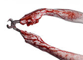 Halloween theme: bloody hand holding a pliers on a white background — Stockfoto