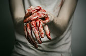 Bloody theme lone murderer: the murderer shows bloody hands and experiencing depression and pain — Zdjęcie stockowe