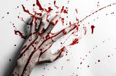 Bloody halloween theme: bloody hand print on a white leaves bloody wall — Stock Photo