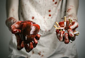 Social advertising and tobacco control: bloody hand holding a cigarette smoker and bloody human heart — Fotografia Stock