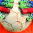 Soccer goalkeeper catching ball with hands — Stock Photo #63728337