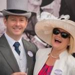 Couple at Royal Ascot laughing at camera — Stock Photo #76559415