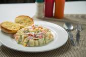 Macaroni salad with mayonnaise and vegetables. — Stock Photo