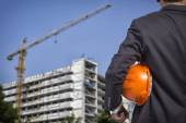 Engineer holding orange helmet for workers security on construct — Stock Photo