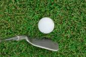 Golf Ball and Golf Club on grass — Stock Photo