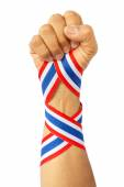 Thai man fist and bind thai flag pattern ribbon on forearm — Stock Photo