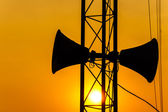 Loudspeaker on pillar and sunset in the evening — Stock Photo
