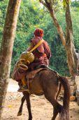 Buddhist monk ride horse — Stock Photo