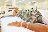 Patient lie on bed in emergency room — Stock Photo