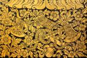 Native thai painting (Flower and vine bind twin axe) on wall of  — Stock Photo