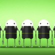 Many robots with glowing heads holding hands — Stock Photo