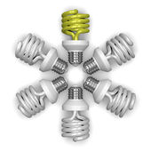 Yellow spiral light bulb and white ones lying radially — Stock Photo
