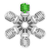 Green spiral light bulb and white ones lying radially — Stock Photo