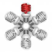 Red spiral light bulb and white ones lying radially — Stock Photo