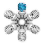 Blue spiral light bulb and white ones lying radially — Stock Photo