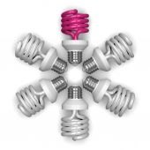 Pink spiral light bulb and white ones lying radially — Stock Photo