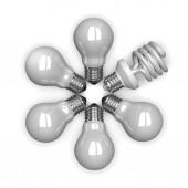 White spiral light bulb among tungsten ones lying ra — Stock Photo