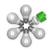 Green spiral light bulb among white tungsten ones — Stock Photo