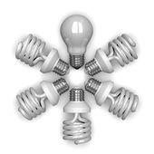 White tungsten light bulb among spiral ones lying — Stock Photo