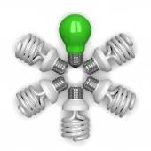 Green tungsten light bulb among white spira — Stock Photo