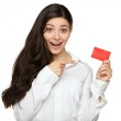 Showing woman presenting blank gift card sign — Stok fotoğraf #53127643