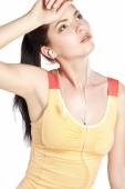 Pretty young woman runner looking tired. — Stock Photo