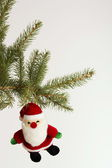 Toy Santa Claus hanging on a Christmas tree — Stock Photo