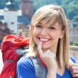 Young backpacker with blonde hair laughing at camera — Stock Photo #77318116